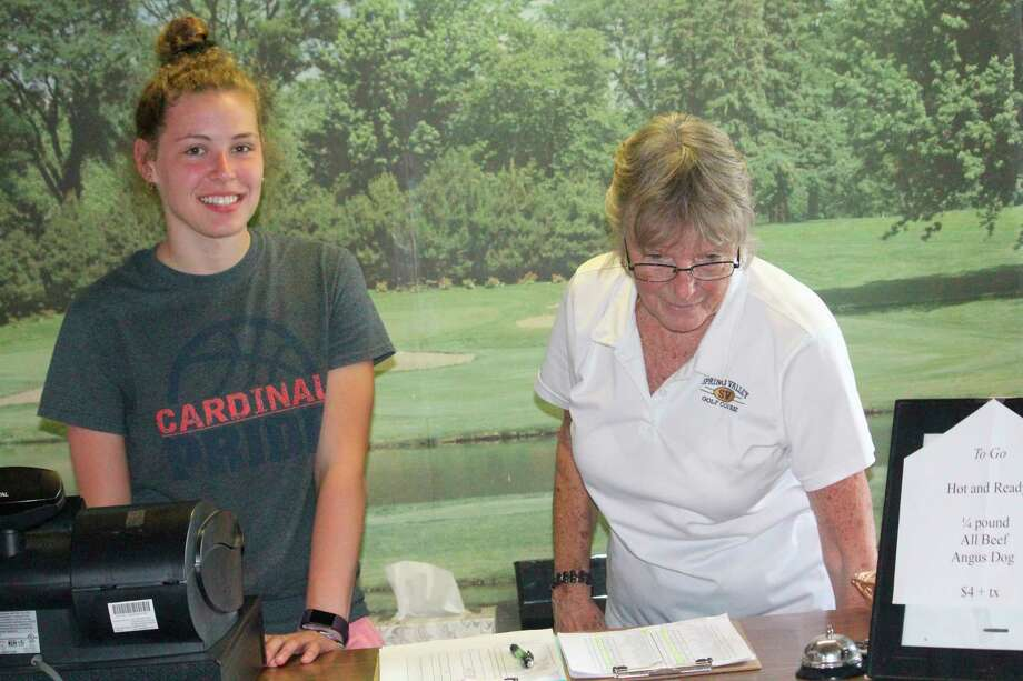 Big Rapids' Megan Mackall (left) and Sharyn McGreehan take care of business at Spring Valley Golf Course during a recent league night. (Pioneer photo/John Raffel)