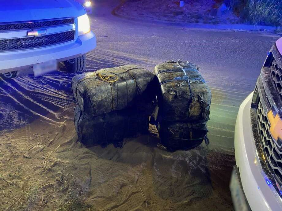 U.S. Border Patrol agents said a group of smugglers abandoned these bundles of marijuana in El Cenizo. Authorities said the contraband weighed 290 pounds and had an estimated street value of $232,000. Photo: Courtesy Photo /U.S. Border Patrol