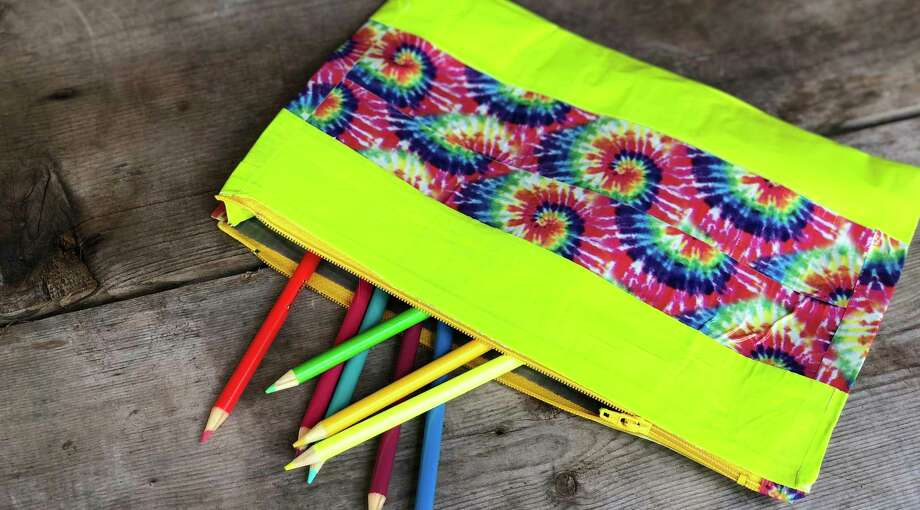 Here is a project adapted from a DoSeum Maker Fashion Camp. Kids get to make a duct tape pencil pouch Photo: Ingrid Wilgen /Express-News Staff