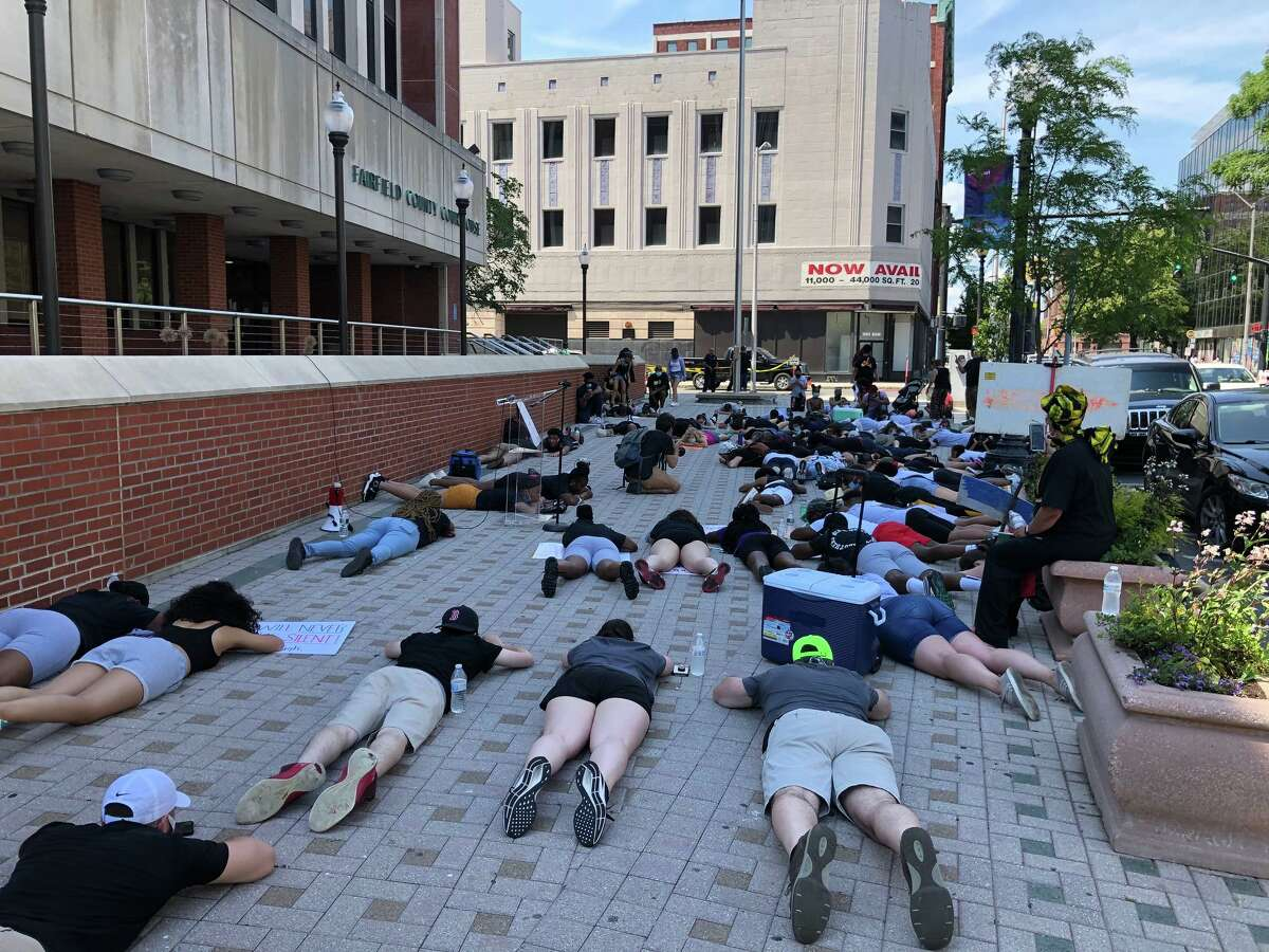 Protesters at a rally at the Fairfield County Court House lay on the ground in silence for more than 8 minutes to symbolize the time George Floyd lay under the knee of a white Minneapolic police officer before Floyd died.