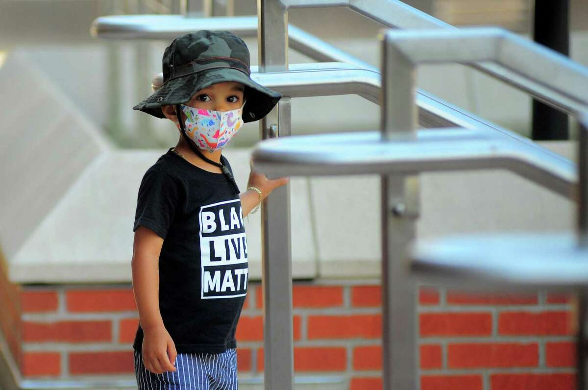 Kayson Harrison, 2, stands on the courthouse steps as he and his mom Jessica (not pictured), protest against police brutality in front of the Fairfield County Courthouse in Bridgeport, Conn., on Friday June 19, 2020.