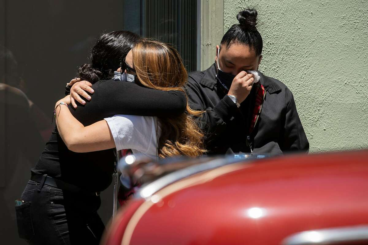 Friends and family of Sean Monterrosa embrace during Monterrosa�s funeral service at the Chapel by the Sea on Friday, June 19, 2020, in Pacifica, Calif. Monterrosa was killed by a Vallejo police officer. Vallejo police chief Shawny Williams said Monterrosa, 22, appeared to be running toward a suspect vehicle just after 12:30 a.m. last Tuesday when he suddenly dropped to his knees and brought his hands above his waist, revealing what an officer mistook for the butt of a firearm. The officer, who was in a vehicle, unloaded five shots through his windshield, striking Monterrosa. The object the officer saw tucked into Monterrosa�s sweatshirt pocket was actually a 15-inch hammer, Williams said.