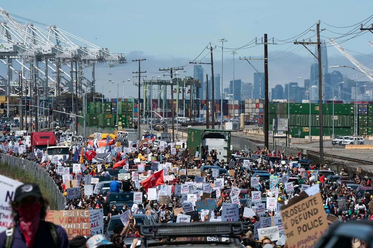 Thousands of people gather during a Juneteenth protest in Oakland, Calif., on Friday, June 19, 2020.