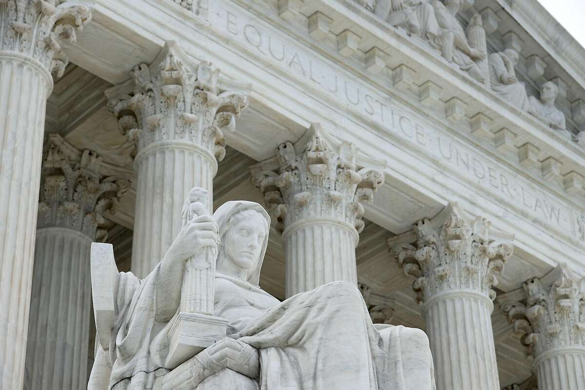 WASHINGTON, DC - JUNE 15: The statue Contemplation of Justice by sculptor James Earle Fraser stands on the steps of the U.S. Supreme Court which ruled that LGBTQ people can not be disciplined or fired based on their sexual orientation June 15, 2020 in Was