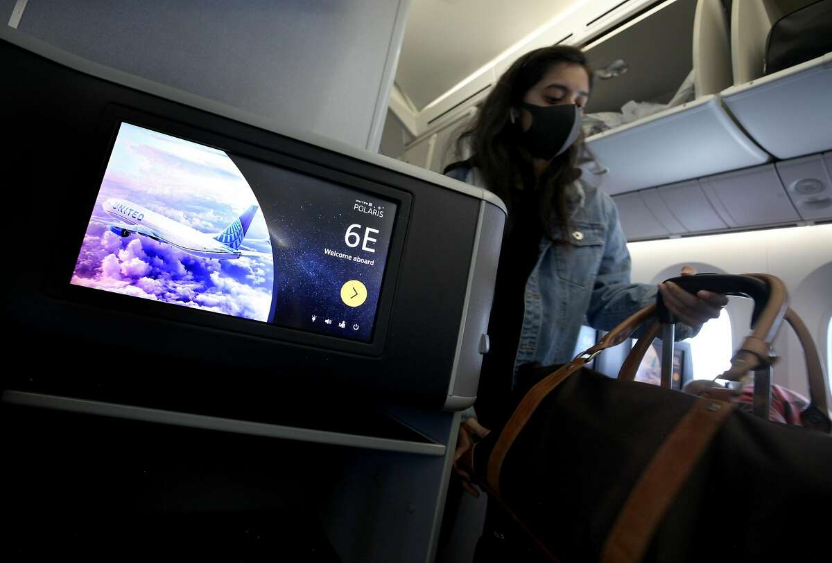 SAN FRANCISCO, CALIFORNIA - MAY 11: A passenger boards a United Airlines flight to Houston, Texas at San Francisco International Airport on May 11, 2020 in San Francisco, California. Air travel is down as estimated 94 percent due to the coronavirus (COVI
