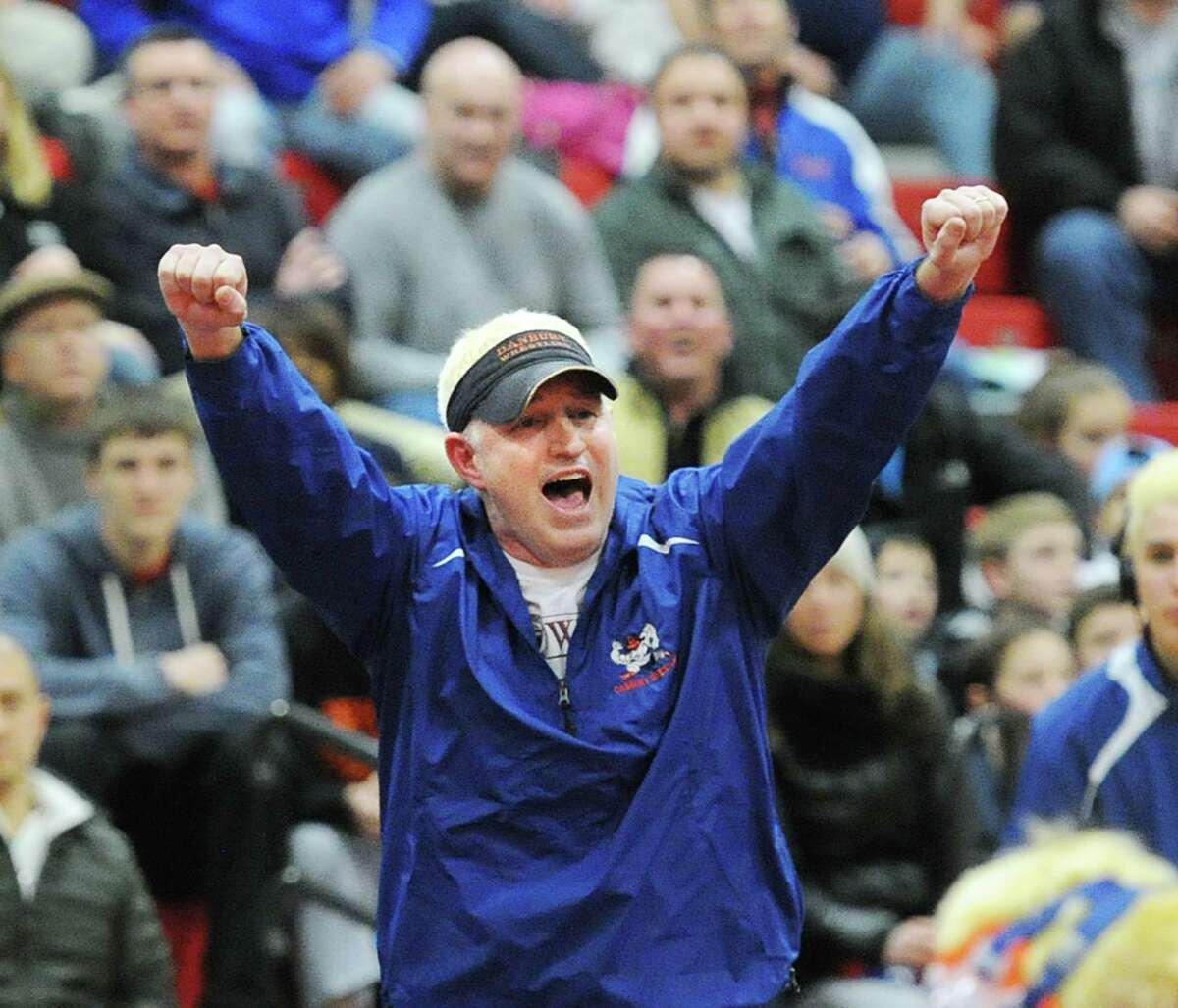 Danbury wrestling coach Ricky Shook reacts during the FCIAC championships in February 2016 at New Canaan High School.