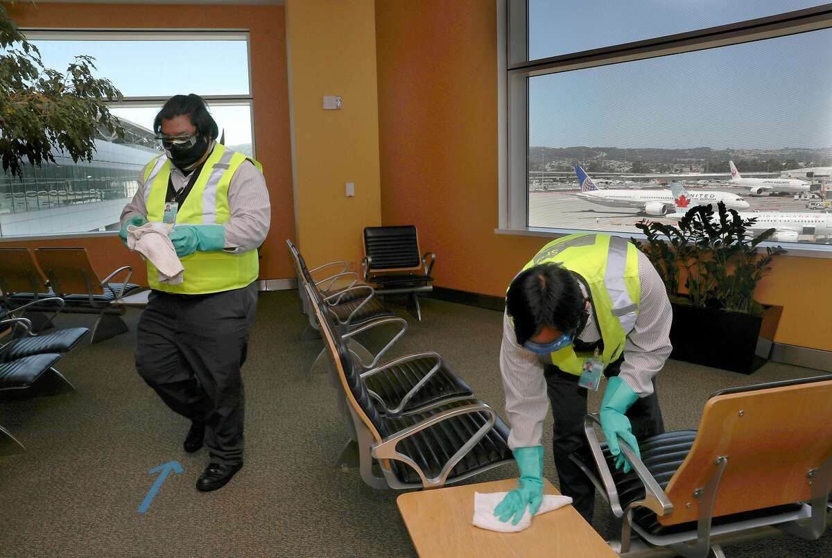 San Francisco International airport custodial staff disinfect the Reflection Room at the SFO international terminal seen on Tuesday, May 26, 2020, in San Francisco, Calif.