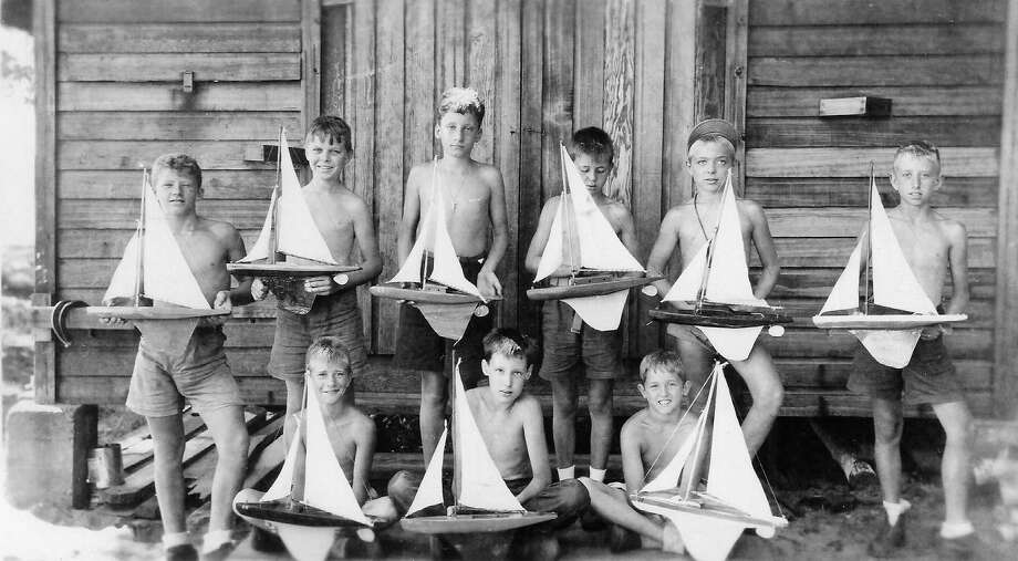 Camp Lookout boys with the sailboats they made, likely during the mid-'40s. (Courtesy Photo)