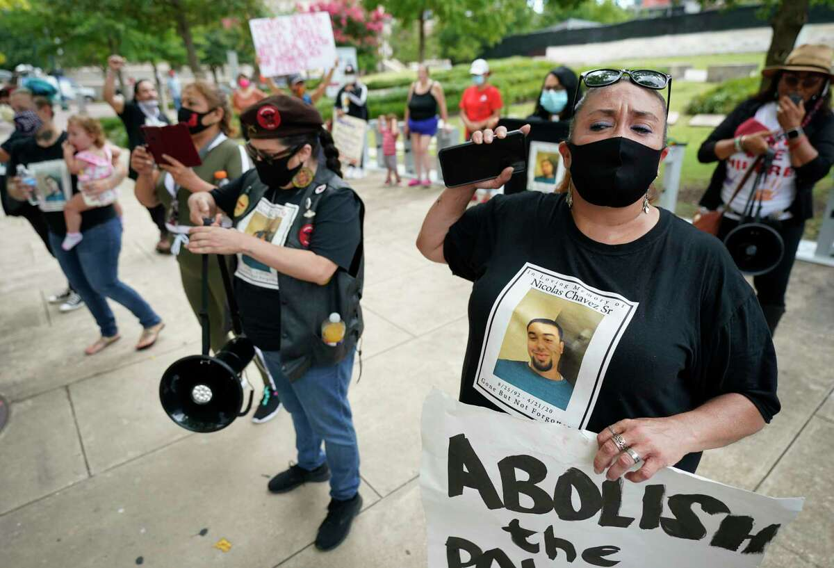 Leantha Chavez, right, who is the mother of Nicolas Chavez, protests with others at the Harris County Criminal Courthouse Friday, June 19, 2020, in Houston. The protesters were denouncing the lack of action in the case of Nicolas Chavez, who was shot and killed by Houston police April 21, 2020.