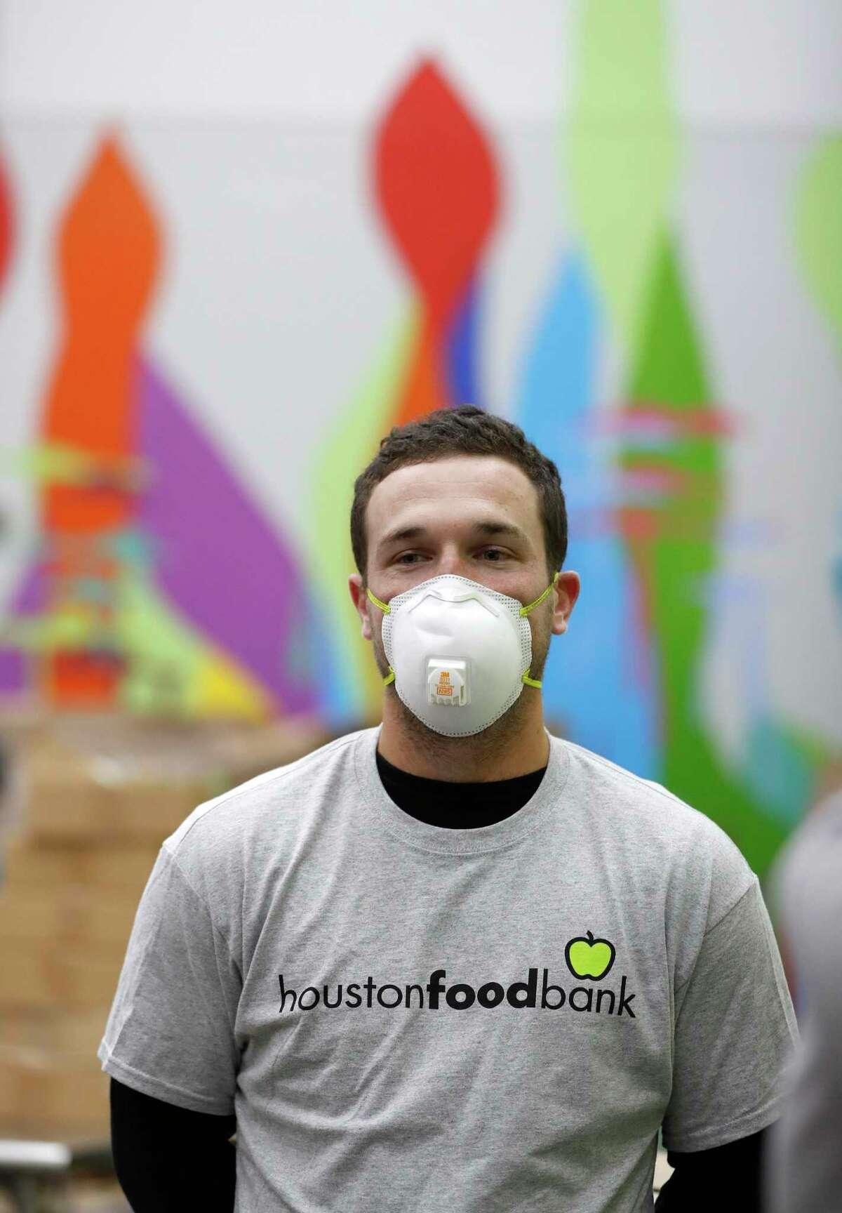 Houston Astros third baseman Alex Bregman volunteers at the Houston Food Bank.