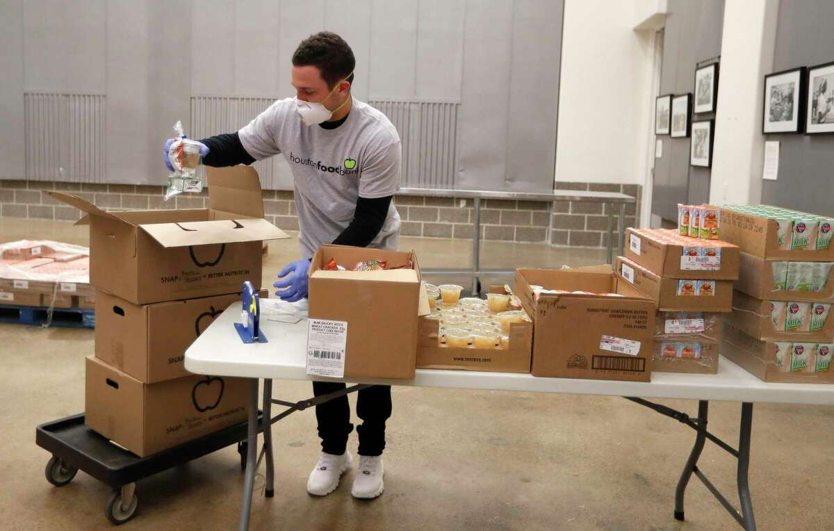 Houston Astros Alex Bregman packages sustainable kids meals at the Houston Food Bank.