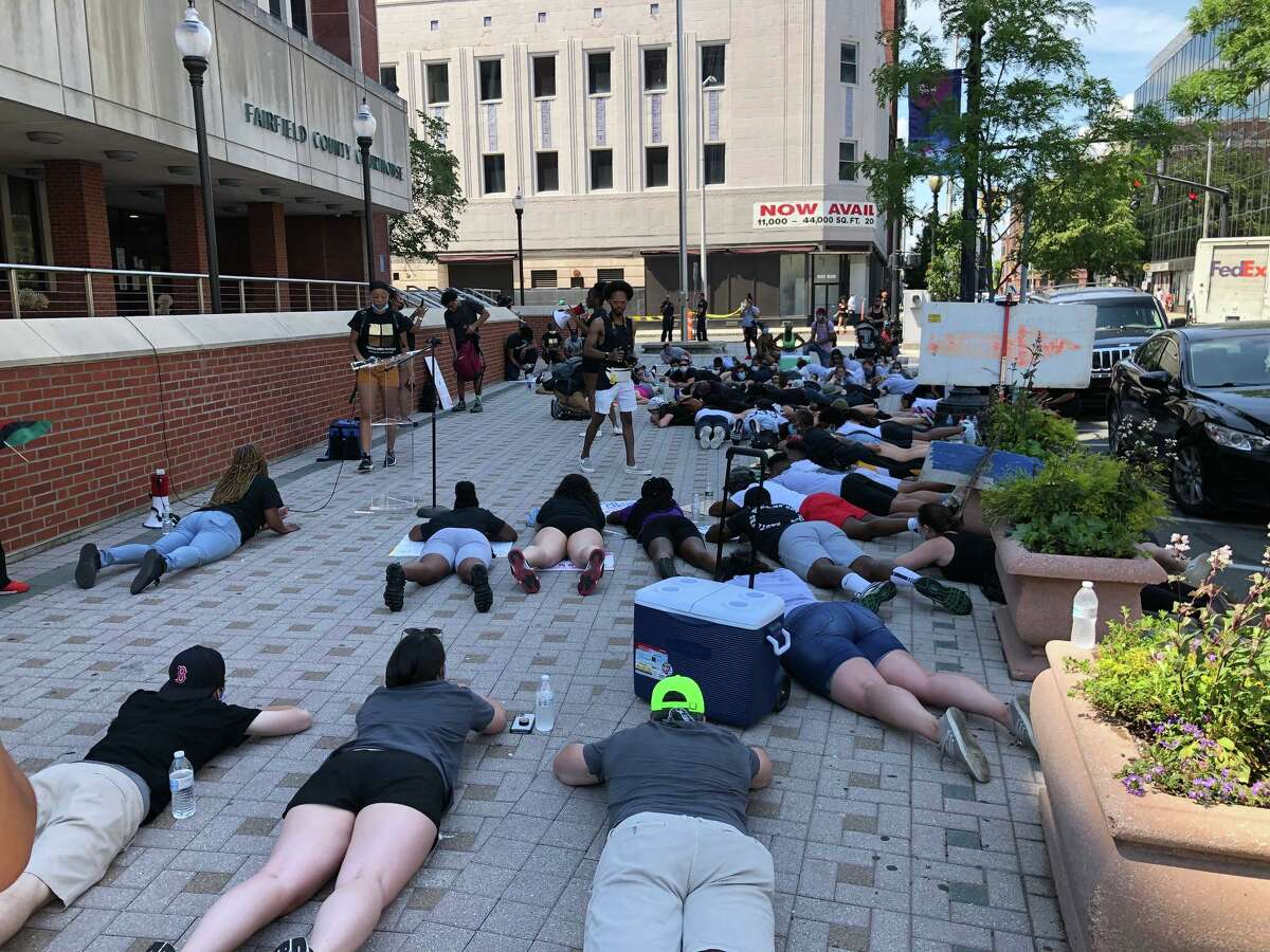 A protest against police brutality is held in front of the Fairfield County Courthouse in Bridgeport, Conn., on Friday June 19, 2020.