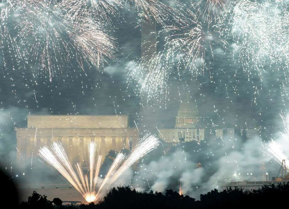 Fourth of July fireworks are seen over the National Mall from across the Potomac River in Arlington, Va., on July 4, 2019. Photo: Washington Post Photo By Marlena Sloss / The Washington Post