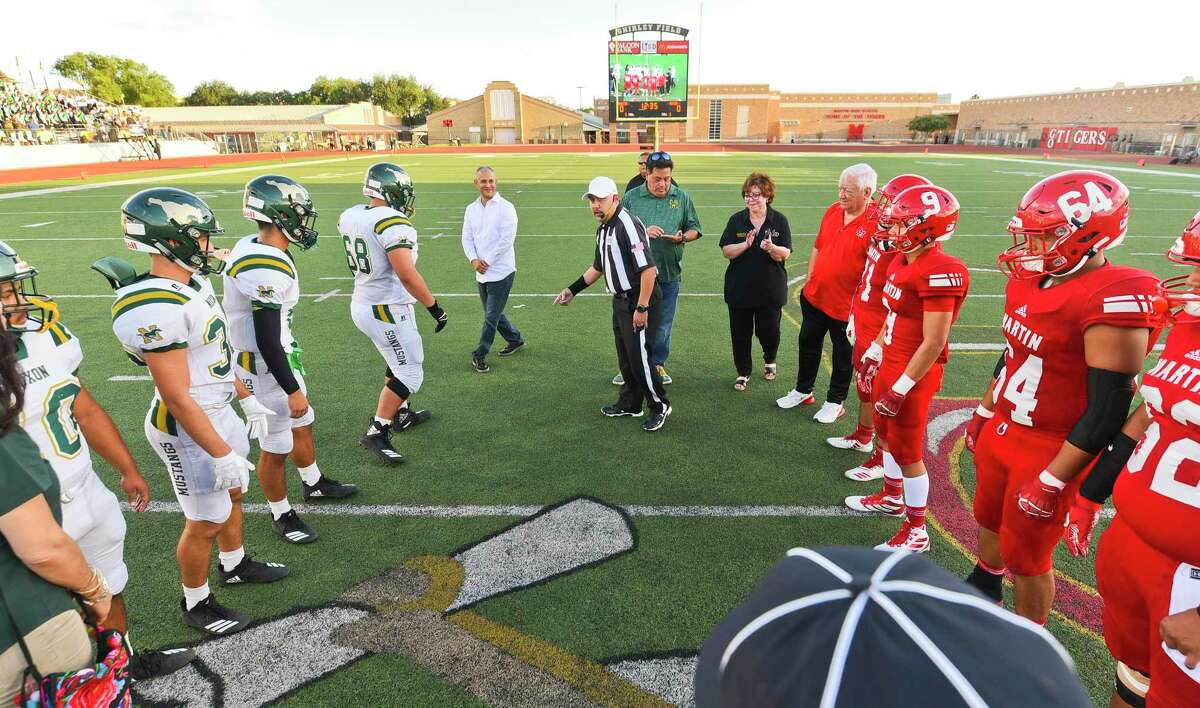 The Nixon High School Mustangs and the Martin High School Tigers line up for the coin toss on Friday, Aug. 30, 2019, at Shirley Field during the Hammer Bowl rivalry football game.