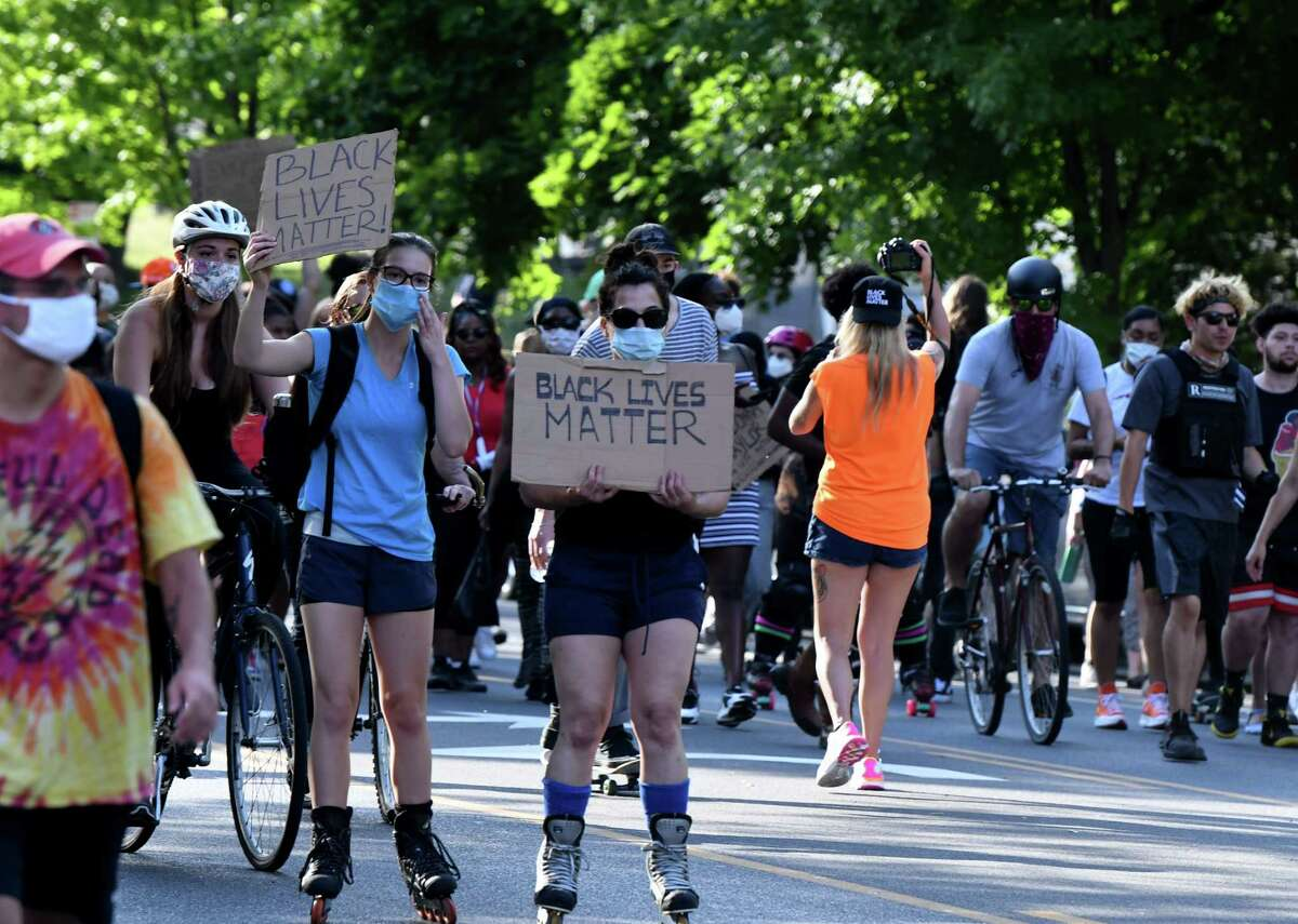 Demonstrators march for equality and an end to police brutality as they head down Madison Avenue from the Washington Park skate park on Friday, June 19, 2020, in Albany, N.Y. Event organizer Prezibai Oki, 24, of Latham wanted to show how the local skate community stands in solidarity with the Black Lives Matter movement. (Will Waldron/Times Union)
