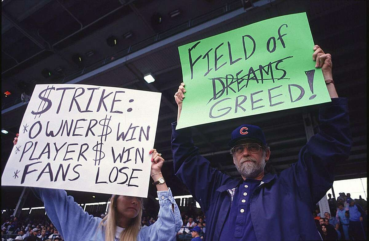 Fans hold up signs in protest of the baseball strike on August 10, 1994 during a game between the San Francisco Giants and the Chicago Cubs at Wrigley Field in Chicago, Illinios. (Photo by Jonathan Daniel/Getty Images/TNS)