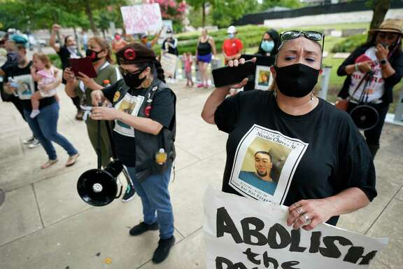 Leantha Chavez, right, who is the mother of Nicolas Chavez, protests with others the Harris County Criminal Courthouse Friday, June 19, 2020, in Houston. The protesters were denouncing the lack of action in the case of Nicolas Chavez, who was shot and killed by Houston police April 21, 2020.