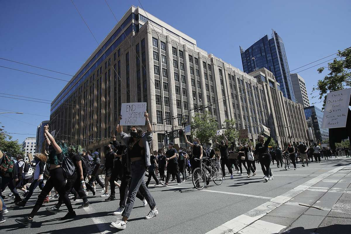 People march on Market Street in San Francisco, Saturday, June 13, 2020, at a protest over the Memorial Day death of George Floyd, who died after being restrained by Minneapolis police. (AP Photo/Jeff Chiu)