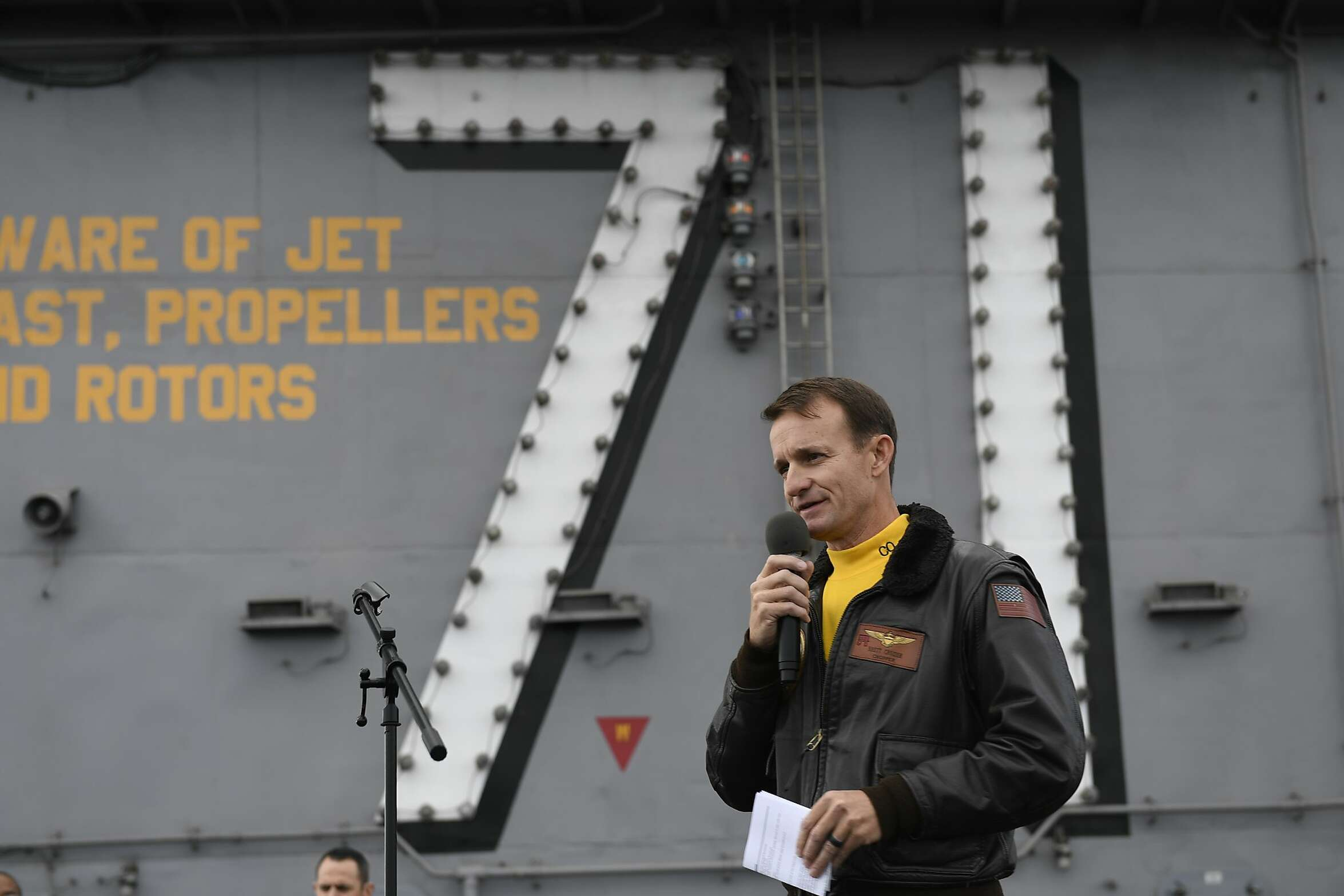 FILE - A photo provided by the U.S. Navy shows Capt. Brett Crozier, then commanding officer of the USS Theodore Roosevelt, addressing his crew during the aircraft carrier's operations in the Eastern Pacific Ocean, Nov. 15, 2019. Crozier and Rear. Adm. Stuart Baker, the ship's two top officers, made poor decisions in response to the coronavirus outbreak onboard the warship, according to the final results of a Navy inquiry released Friday, June 19, 2020. (U.S. Navy via The New York Times)