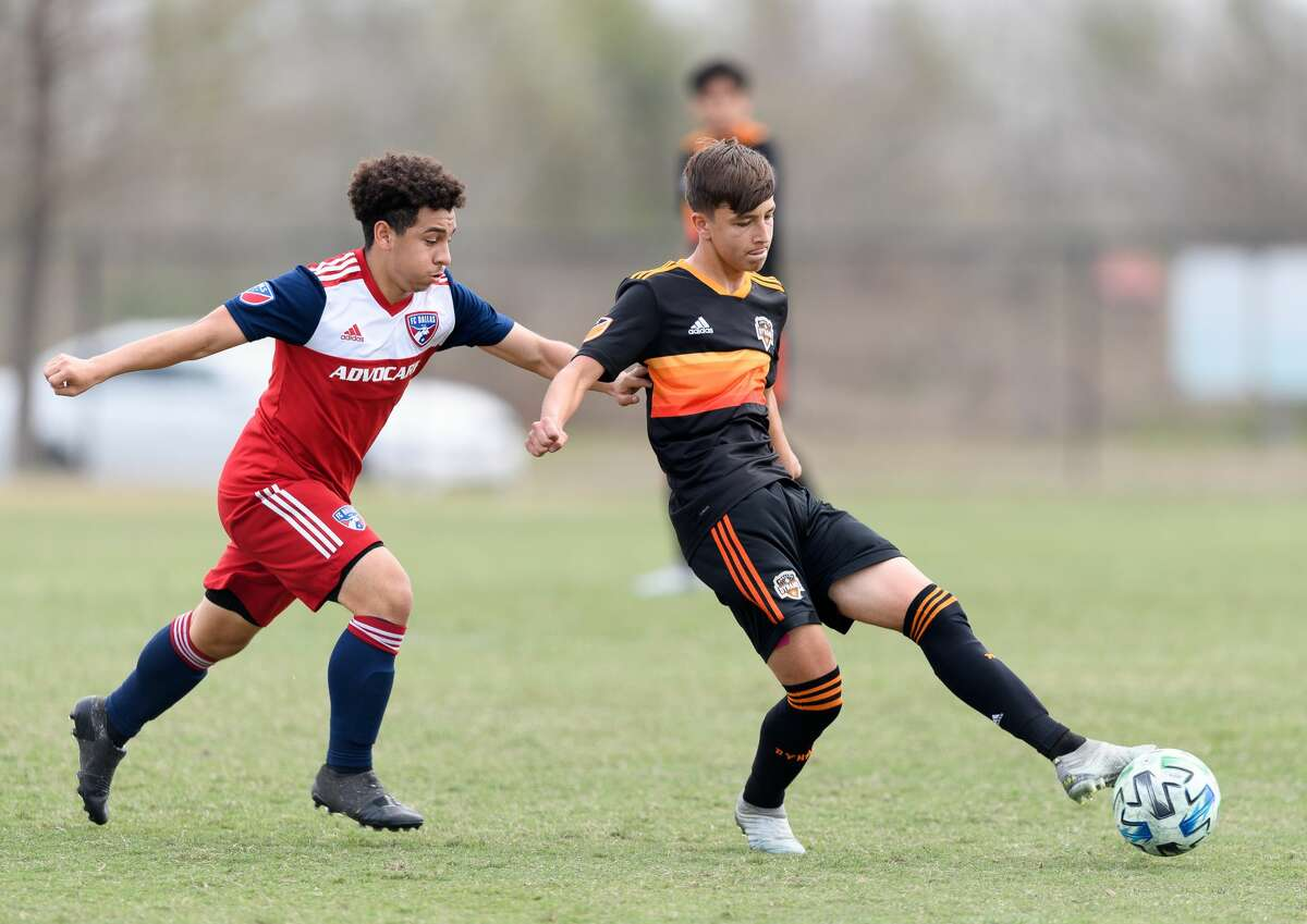 Juan Castilla, right, who turns 16 next month, is the youngest player to be signed to a homegrown contract with the Dynamo.