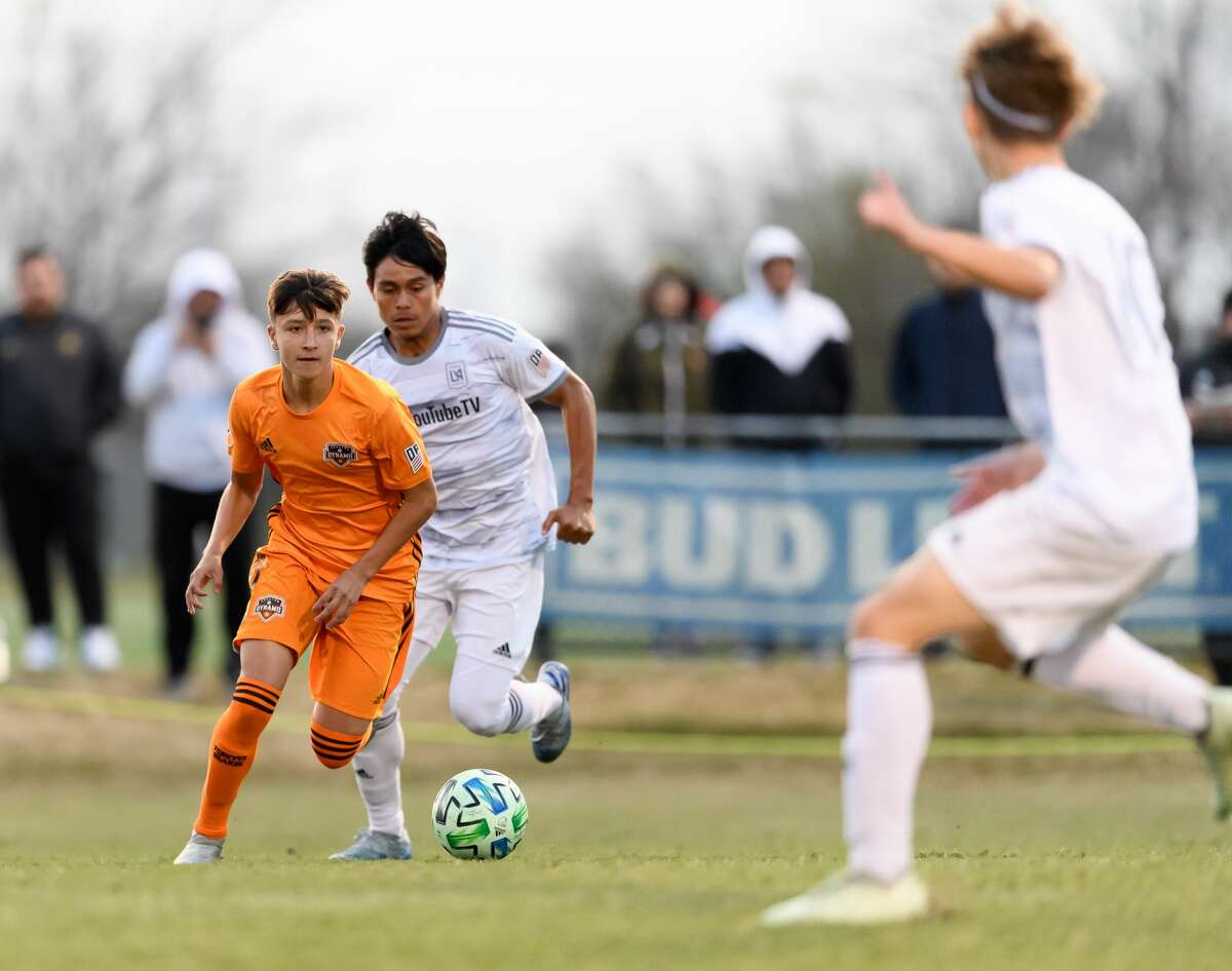 Juan Castilla, in orange, has practiced with the Dynamo first team and can make his MLS debut in 2021.