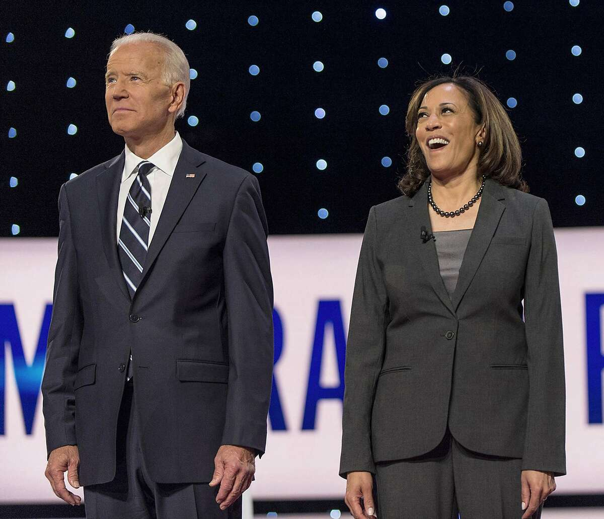 Joe Biden and Kamala Harris pose for the photo spray during a commercial break at the second of two Democratic Debates in Detroit hosted by CNN and sanctioned by the DNC. (Brian Cahn/Zuma Press/TNS)