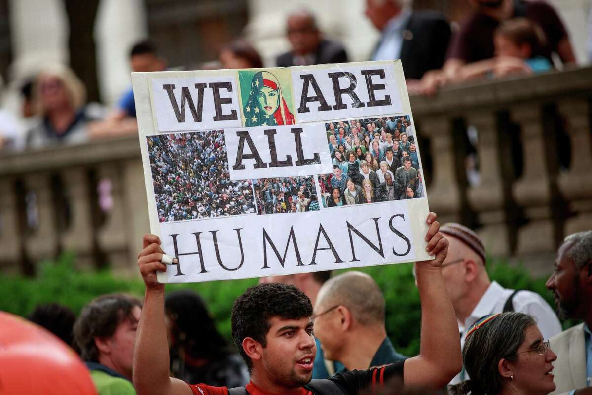 People rally to support immigrants and to mark World Refugee Day 2018 in Midtown Manhattan in New York City. The Trump administration has dratically cut the number of refugees that are resettled in the United States.
