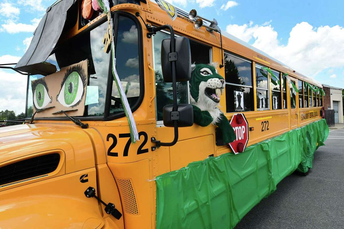 A school bus is decorated with the Sabres mascot in a window as graduates pick up their diplomas during a drive through graduation at Schalmont High School on Friday, June 19, 2020 in Rotterdam, N.Y. (Lori Van Buren/Times Union)
