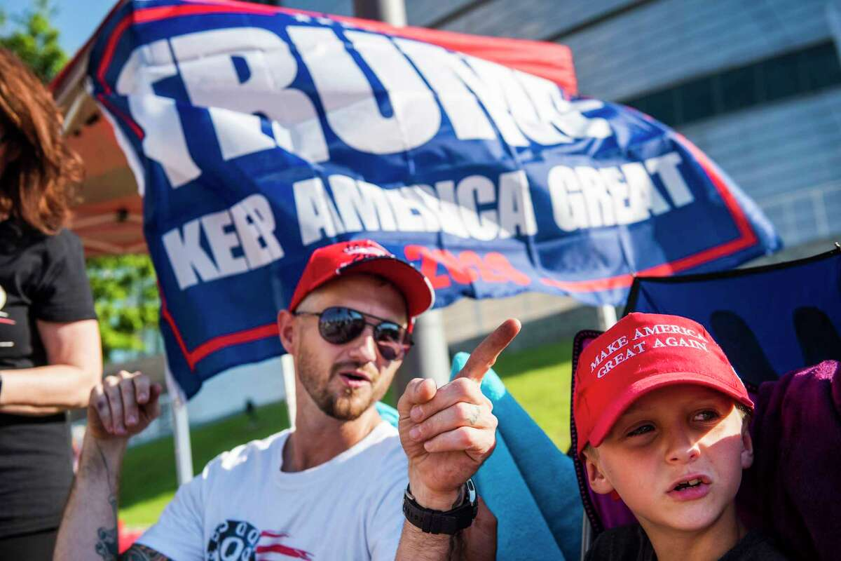 Zach Moushon and his son, Holden Moushon, 8, camp with fellow Donald Trump supporters outside the BOK Center in Tulsa, Oklahoma, on June 17, 2020, days before the start of the official rally.