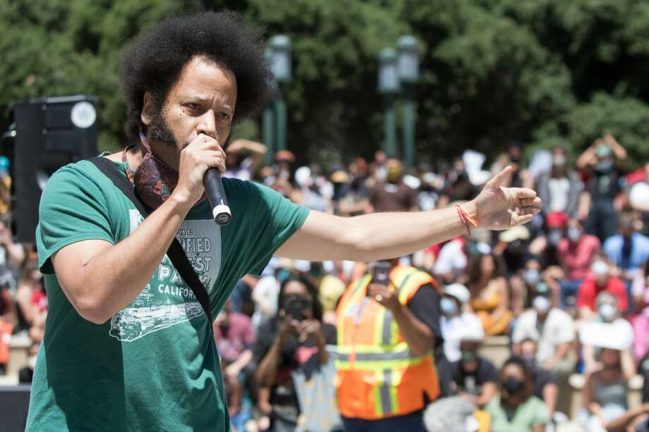 """FILE - Boots Riley speaks at a Juneteenth demonstration in front of Oakland City Hall on June 19, 2020. On Monday morning, the rapper and filmmaker announced he's working on a new TV series, """"I'm A Virgo."""" The film will follow a 13-foot-tall Black man living in Oakland, portrayed by Jharrel Jerome. Photo: Douglas Zimmerman/SFGate.com, Boots Riley Speaks To At A Rally At City Hall / SFGate.com"""