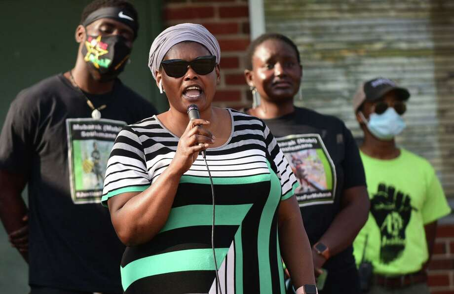 Omo Klusum Mohammed, mother of Mubarak Soulemane, who was slain by police speaks as over 200 people gathered at Veterans Memorial Park on Friday, to celebrate Juneteenth and protest police brutality in Norwalk. Photo: Erik Trautmann / Hearst Connecticut Media / Norwalk Hour