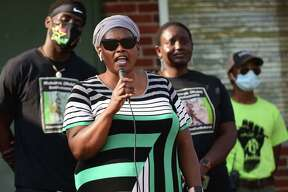 Omo Klusum Mohammed, mother of Mubarak Soulemane, who was slain by police speaks as over 200 people gathered at Veterans Memorial Park on Friday, to celebrate Juneteenth and protest police brutality in Norwalk.