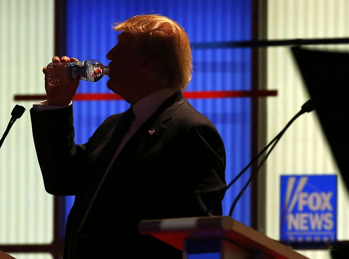 Republican presidential candidate, businessman Donald Trump takes a drink of water during a commercial break at a Republican presidential primary debate at Fox Theatre, Thursday, March 3, 2016, in Detroit. (AP Photo/Paul Sancya)