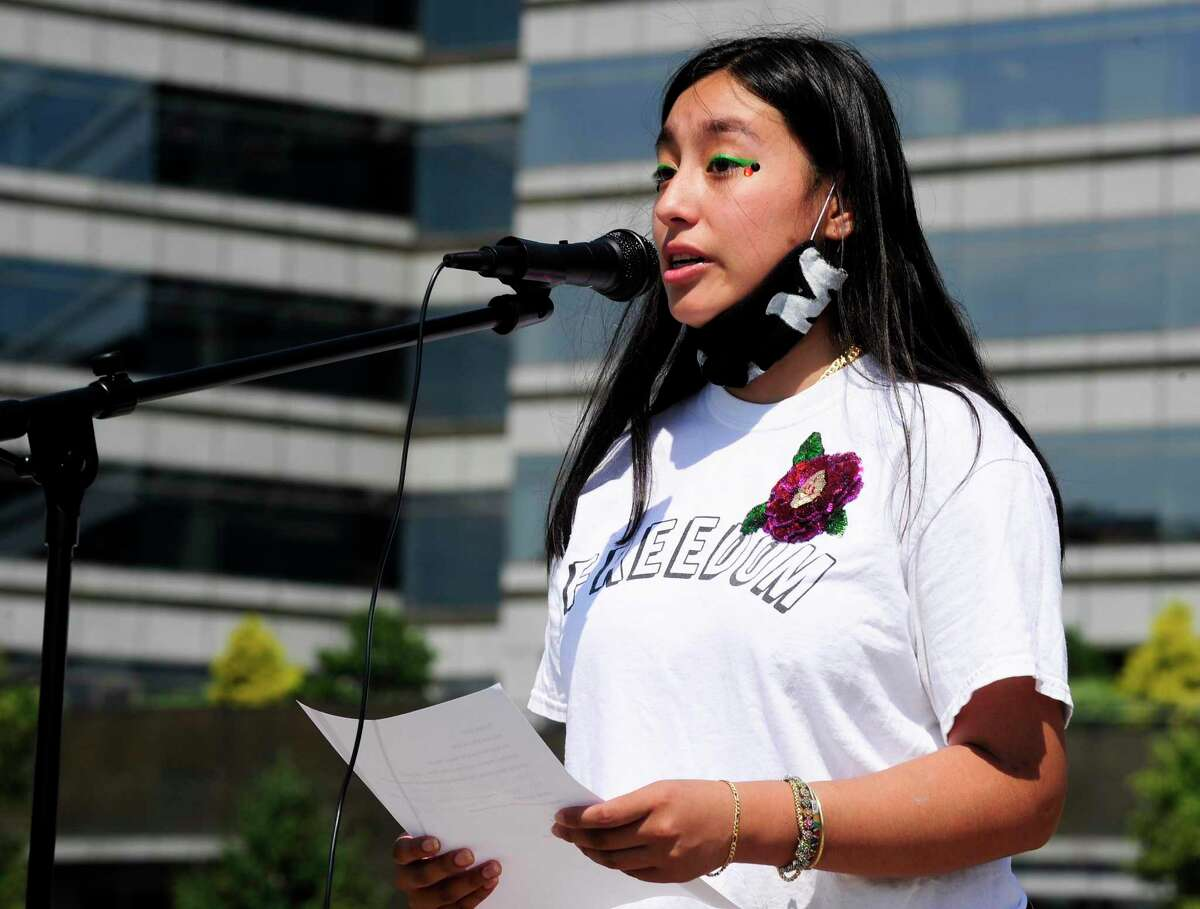 Organizer Victoria Iparraguirre of Stamford speaks during the Speak Your Peace Rally at Mill River Park in Stamford, Connecticut on June 19, 2020. STAMFORD - Victoria Iparraguirre, a Stamford resident and junior at the Manhattan School of Music, told the crowd gathered on the sun-splashed lawn of Mill River Park Friday that the day they were there to mark is