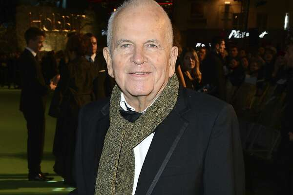 "FILE - In this Dec. 12, 2012 file photo, actor Ian Holm appears at the premiere of ""The Hobbit: An Unexpected Journey"" in London. Holm, the acclaimed British actor whose long career included roles in ""Chariots of Fire"" and ""The Lord of the Rings"" has died, his agent said Friday. He was 88. Holm died peacefully in the hospital, surrounded by his family and carer, his agent, Alex Irwin, said in a statement. His illness was Parkinson's related. (Photo by Jon Furniss/Invision/AP, File)"
