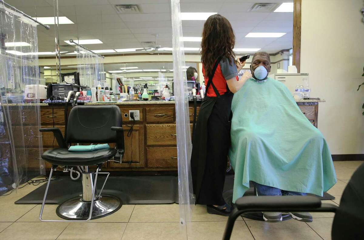 Retired Army Staff Sgt. Louis Solomon Jr. gets a haircut Friday at Olympic Barber & Beauty in Harker Heights, near Fort Hood. Nationwide protests by Black Lives Matter have renewed a call to rebrand the 10 Army posts named for Confederate generals, including Fort Hood. The debate has sharpened within the military. Solomon said he was not opposed to a name change.
