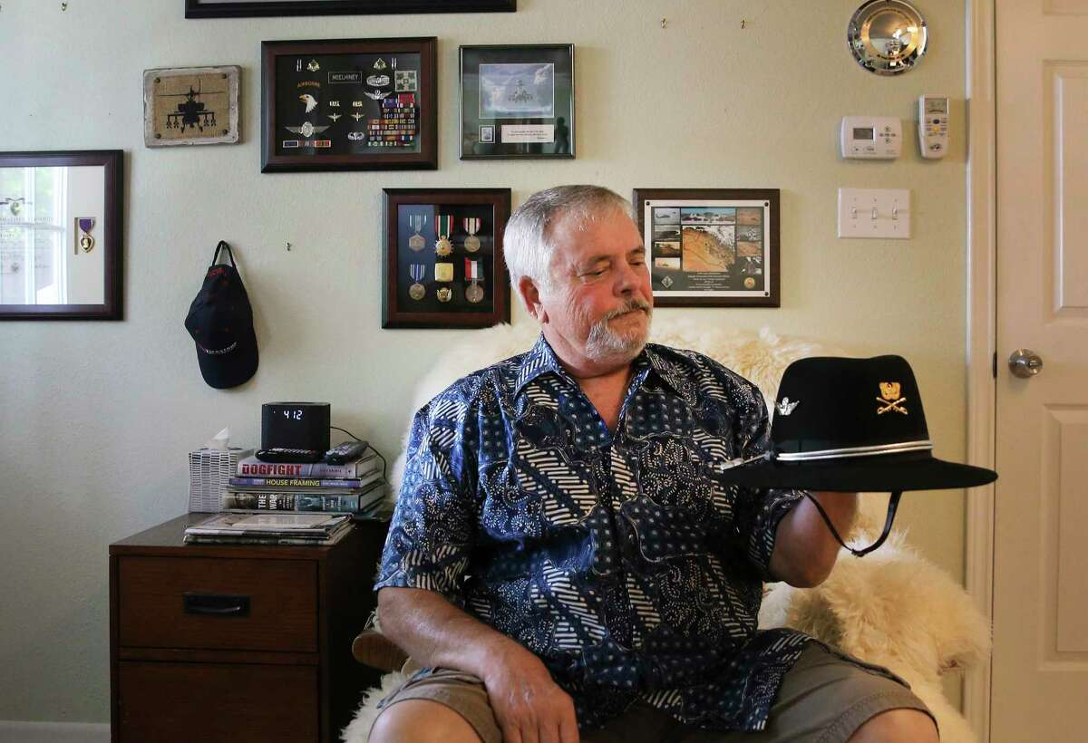 Lance McElhiney, retired chief warrant officer, displays his Calvary hat at his home near Fort Hood. There has been a renewed call to remove Confederate statues and rename military installations. Fort Hood, in Killeen, is named after Confederate general John Bell Hood. McElhiney, a decorated helicopter pilot during the Vietnam War, is opposed to the changing the name. A reader sees it much differently.