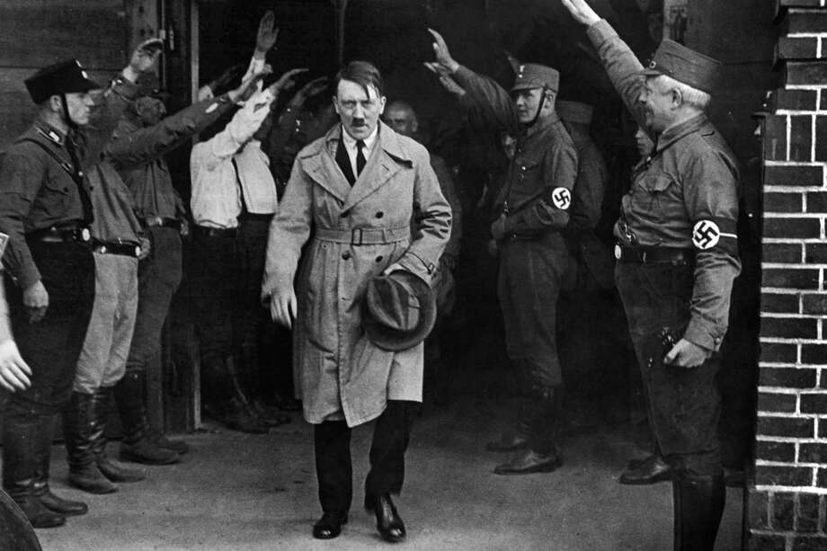 "FILE - In this Dec. 5, 1931 file photo Adolf Hitler, leader of the National Socialists, leaves the party's Munich, Germany headquarters. On Friday, June 12, 2020, The Associated Press reported on stories circulating online incorrectly asserting that Hitler defunded the police and installed his own enforcers. Gavriel D. Rosenfeld, a historian and history professor at Fairfield University says, ""Let's just say the Nazis did everything BUT defund the police,"" noting that Nazis made the police one of the chief recipients of state financial support aside from military spending. (AP Photo/File) Photo: AP / Copyright 2020 The Associated Press. All rights reserved."