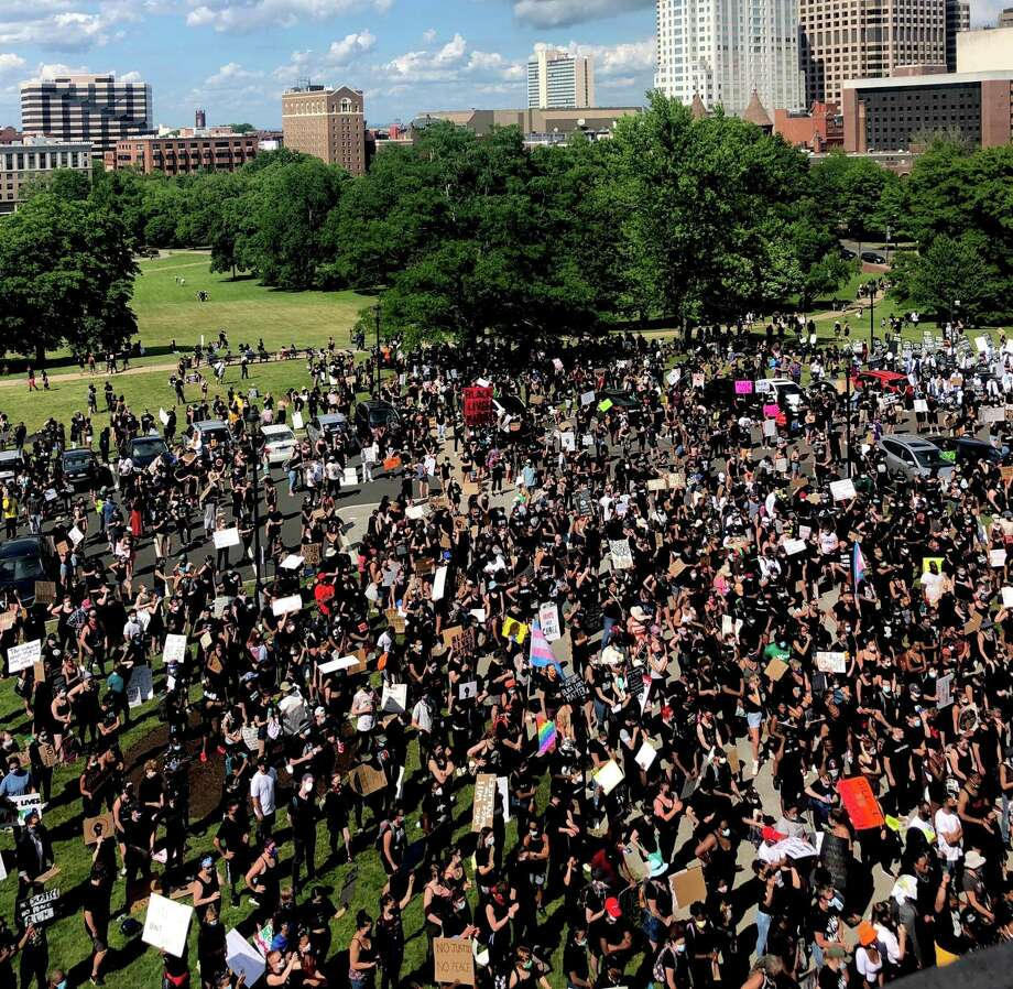 A crowd estimated at 3,000 surged toward the state Capitol on Friday, June 19, 2020 to rally for Juneteenth before marching through the streets of Hartford. Photo: Kaitlyn Krasselt/Hearst Connecticut Media