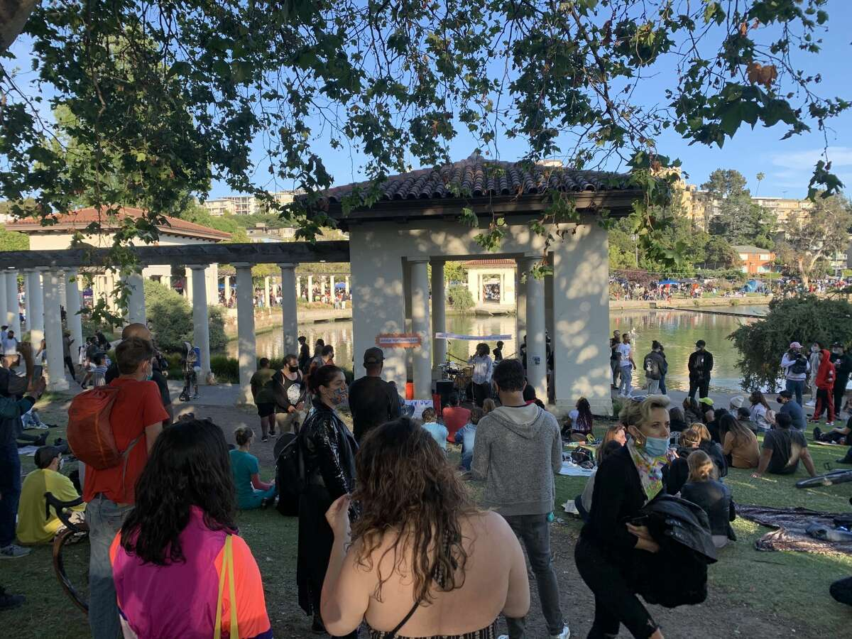 People gathered Friday evening for Justice for Juneteenth, a celebration featuring Black speakers, comedians, poets, musicians and historians at Oakland's Lake Merritt.