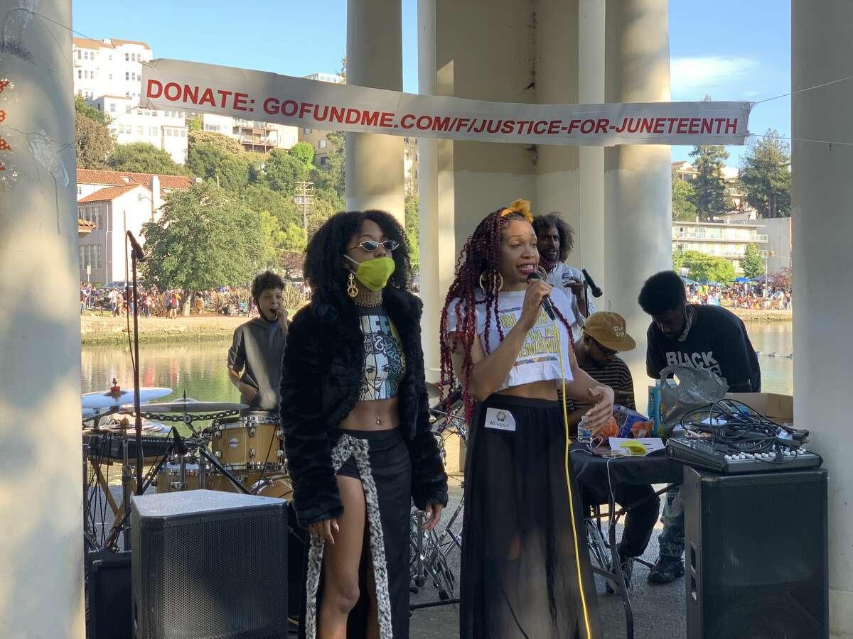 Justice for Juneteenth organizers Paige Morris and Marina Adams speak at Lake Merritt.