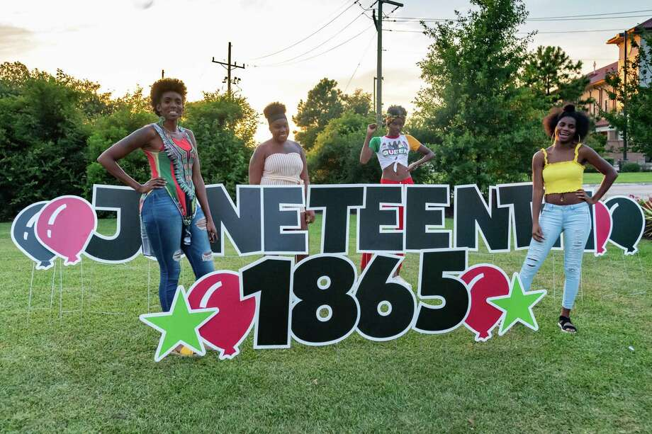 Friends get their picture taken with the Juneteenth sign as the Juneteenth celebration in Beaumont at Dr. Martin Luther King Junior Memorial Park on Friday revolved around family, friends, fellowship, food, and most important, the desire for true freedom. Photo made on June 19, 2020.  Fran Ruchalski/The Enterprise Photo: Fran Ruchalski, The Enterprise / The Enterprise / © 2020 The Beaumont Enterprise