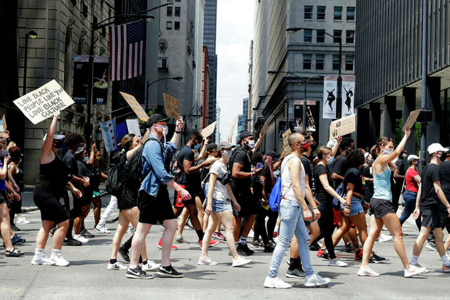 People march Friday in Chicago to mark Juneteenth, a holiday celebrating the day in 1865 that enslaved black people in Galveston, Texas, learned they had been freed from bondage, more than two years after the Emancipation Proclamation. Photo: Nam Y. Huh | AP