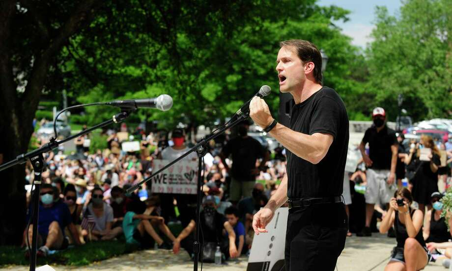 U.S. Representative Jim Himes speaks during a rally outside Greenwich Town Hall on June 6. Photo: Matthew Brown / Hearst Connecticut Media / Stamford Advocate
