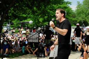 U.S. Representative Jim Himes speaks during a rally outside Greenwich Town Hall on June 6.