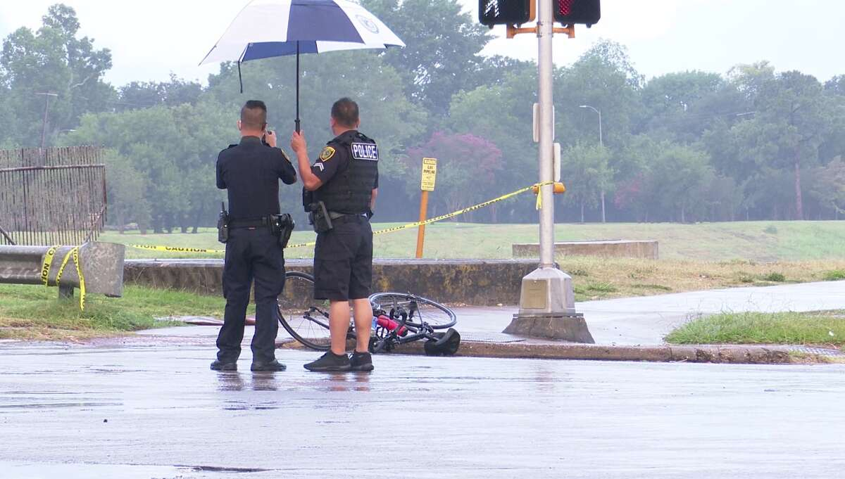 Investigators are searching for a car that struck and killed a bicyclist early Saturday morning on a feeder road for the South Loop.