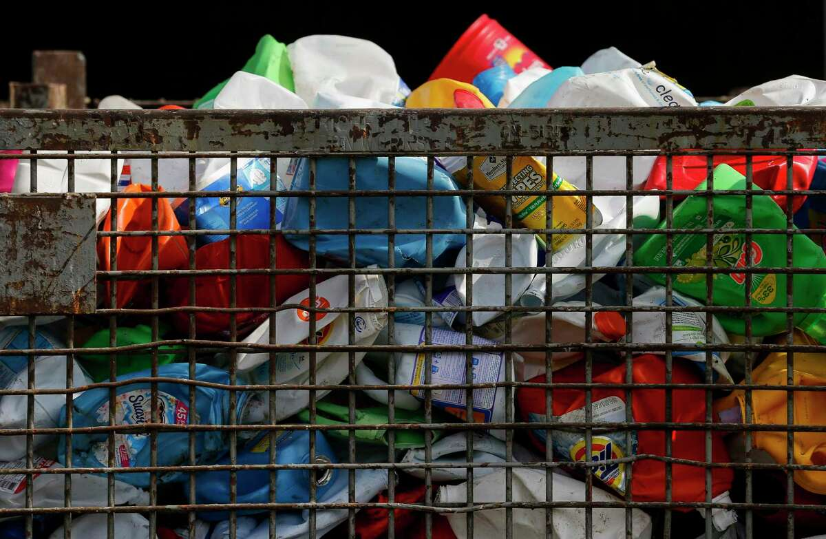 Plastic bottles sorted by an AMP Robotics machine are separated in this container after making its way through the Balcones Resources recycling facility Monday, Dec. 9, 2019, in Austin, Texas.