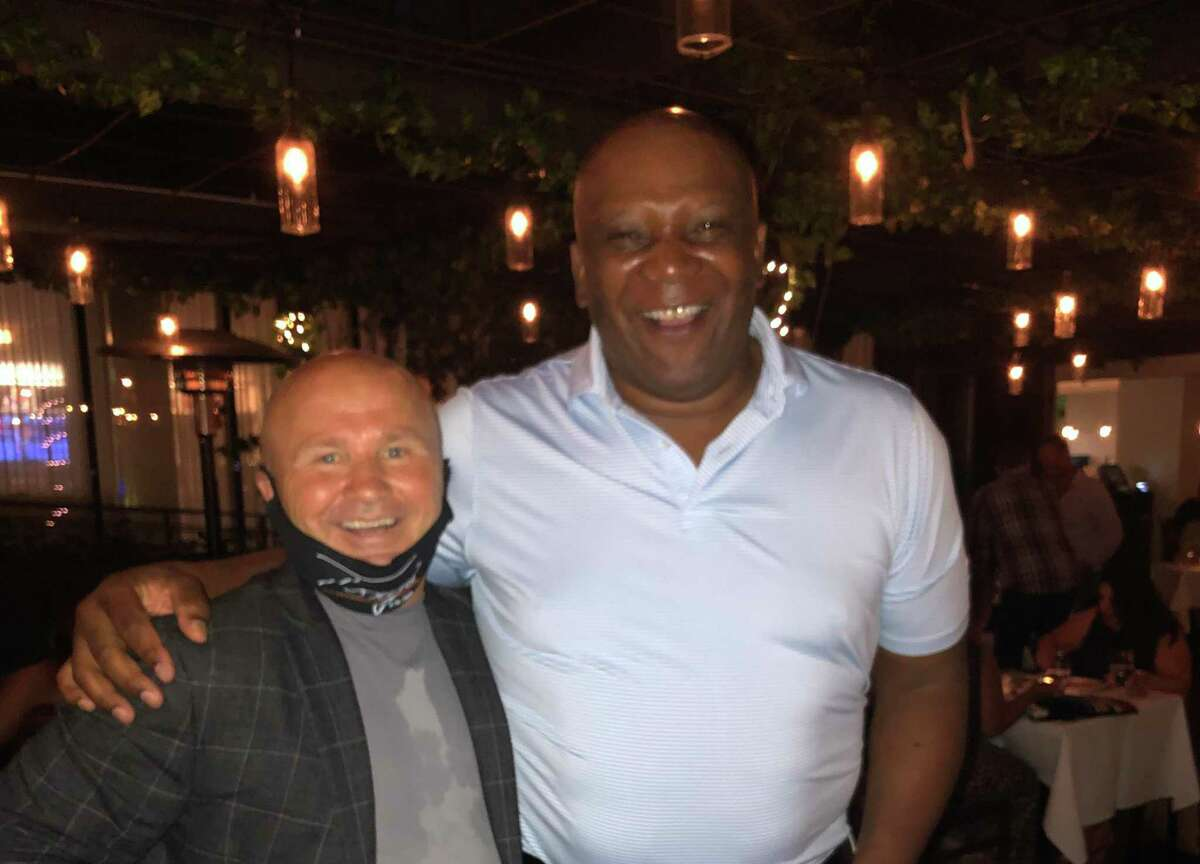 Restaurateur Tony Capasso, owner of Tony's at the JHOUSE, with former New York Giant Howard Cross at Tony's on Thursday night
