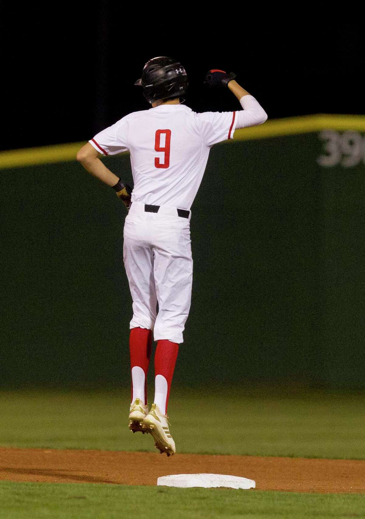 Coltin Atkinson #9 of Porter reacts after hitting an RBI double during the fourth inning of a District 20-5A high school baseball game at Porter High School, Tuesday, March 12, 2019, in Porter.