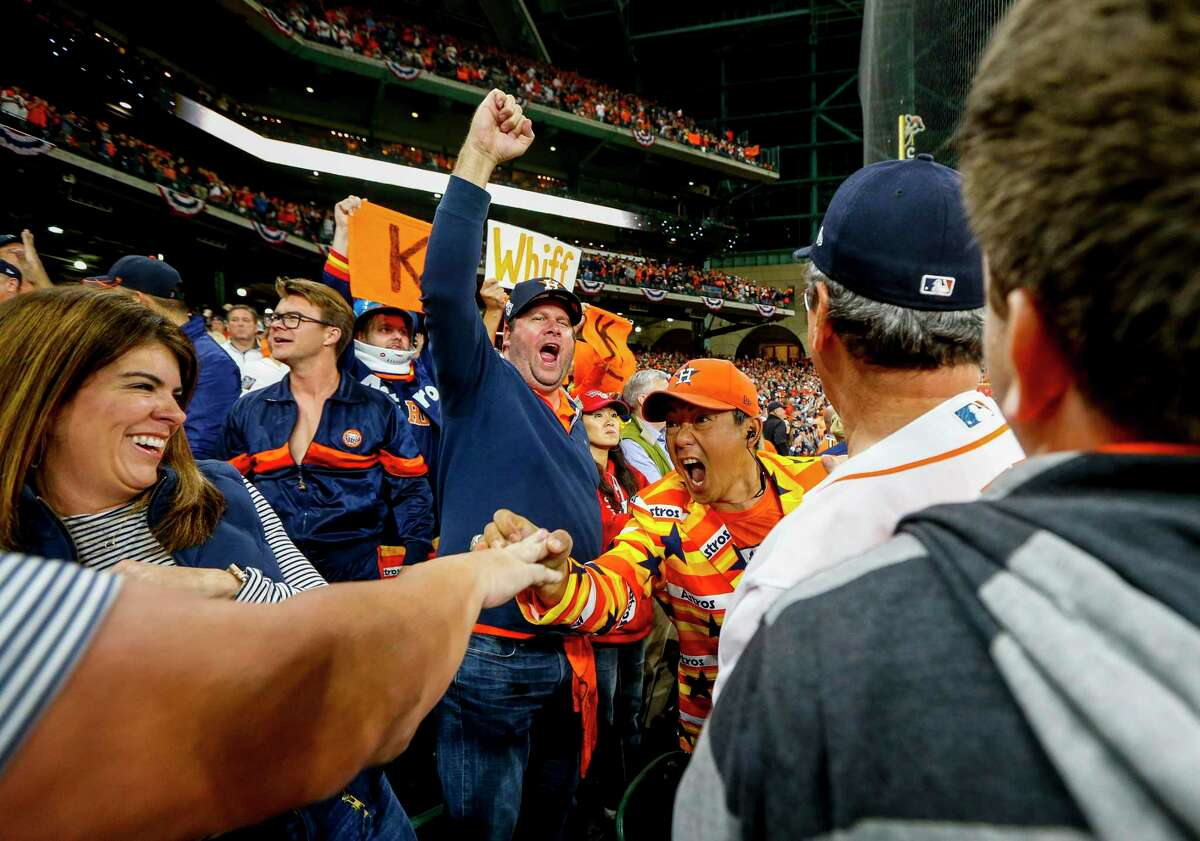 The natural reaction for fans to cheer and interact, as during the World Series, is a recipe for potentially spreading the coronavirus, experts warn.